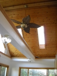 New skylights and perfectly installed tongue and groove throughout the family room.